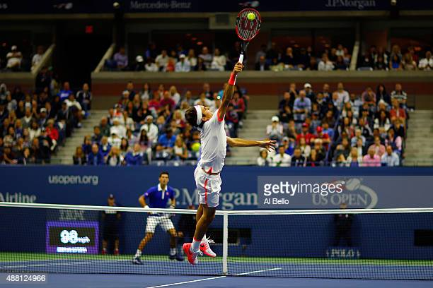 Roger Federer of Switzerland returns a forehand shot to Novak Djokovic of Serbia during their Men's Singles Final match on Day Fourteen of the 2015...