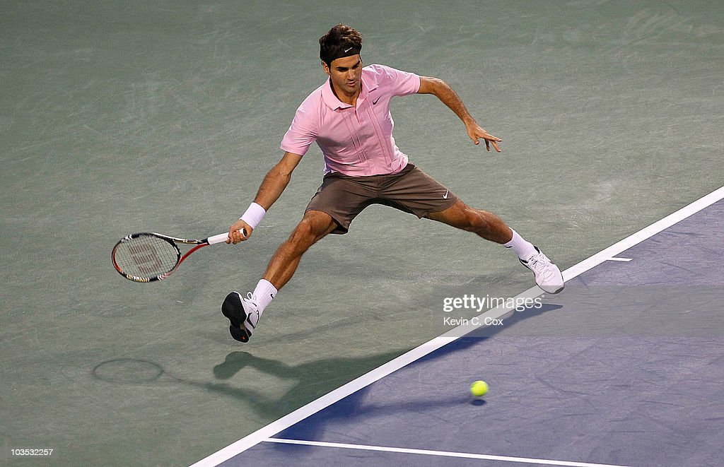 Roger Federer of Switzerland returns a forehand to Marcos Baghdatis of Cyprus during the semifinals on Day 6 of the Western & Southern Financial Group Masters at the Lindner Family Tennis Center on August 21, 2010 in Cincinnati, Ohio.