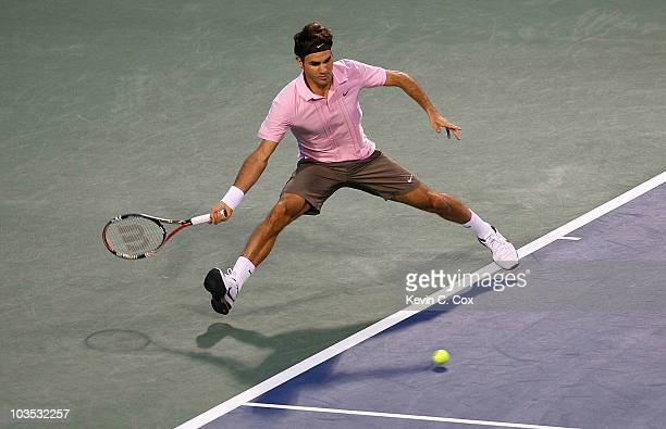 Roger Federer of Switzerland returns a forehand to Marcos Baghdatis of Cyprus during the semifinals on Day 6 of the Western Southern Financial Group...