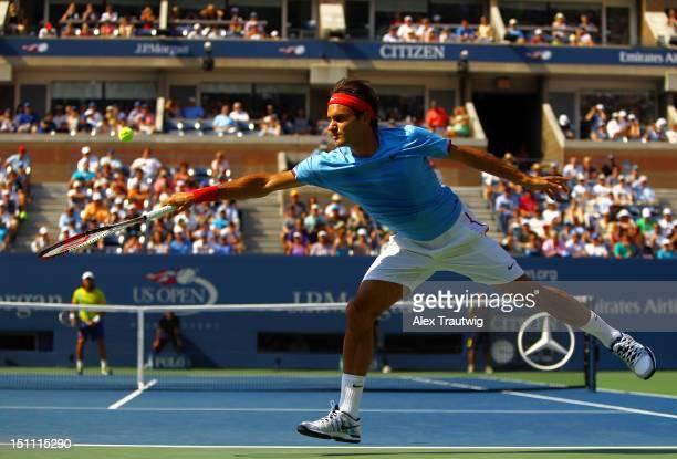 Roger Federer of Switzerland returns a shot against Fernando Verdasco of Spain during their men's singles third round match on Day Six of the 2012 US...