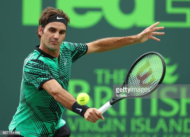 Roger Federer of Switzerland returns a shot against Frances Tiafoe during day 6 of the Miami Open at Crandon Park Tennis Center on March 25 2017 in...