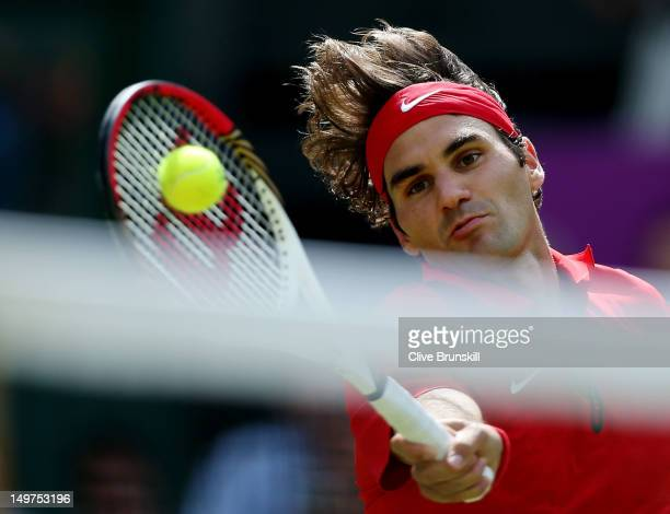 Roger Federer of Switzerland returns a shot against Juan Martin Del Potro of Argentina in the Semifinal of Men's Singles Tennis on Day 7 of the...