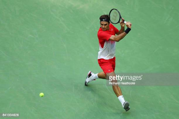 Roger Federer of Switzerland returns a shot against Mikhail Youzhny of Russia during their second round Men's Singles match on Day Four of the 2017...