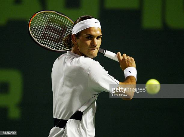 Roger Federer of Switzerland returns a shot against Rafael Nadal of Spain on March 28 2004 during Nasdaq 100 Open at the Crandon Park Tennis Center...