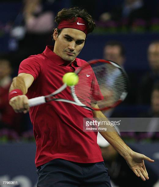 Roger Federer of Switzerland returns a shot against Rafael Nadal of Spain during their semi-final match in the Tennis Masters Cup at Qi Zhong Stadium...