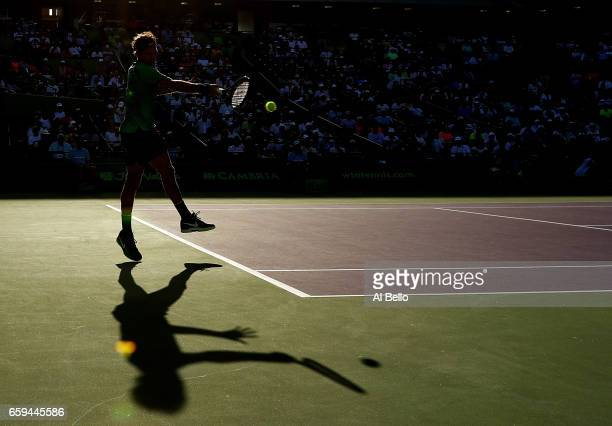Roger Federer of Switzerland returns a shot against Roberto Bautista Agut of Spain during Day 9 of the Miami Open at Crandon Park Tennis Center on...