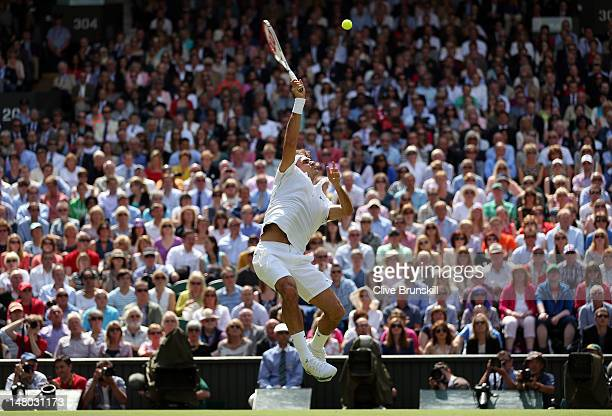 Roger Federer of Switzerland returns a shot during his Gentlemen's Singles final match against Andy Murray of Great Britain on day thirteen of the...