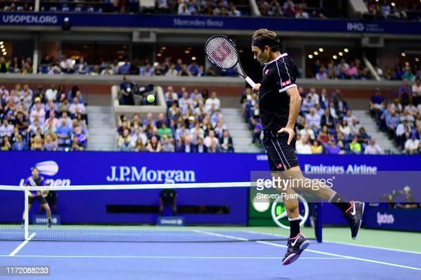 Roger Federer of Switzerland returns a shot during his Men's Singles quarterfinal match against Grigor Dimitrov of Bulgaria on day nine of the 2019...