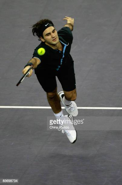 Roger Federer of Switzerland returns a shot during his round robin match against Andy Murray of Great Britain in the Tennis Masters Cup held at Qi...