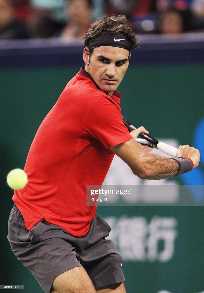 Roger Federer of Switzerland returns a shot his match against Roberto Bautista Agut of Spain during the day 5 of the Shanghai Rolex Masters at the Qi Zhong Tennis Center on October 9, 2014 in Shanghai, China.