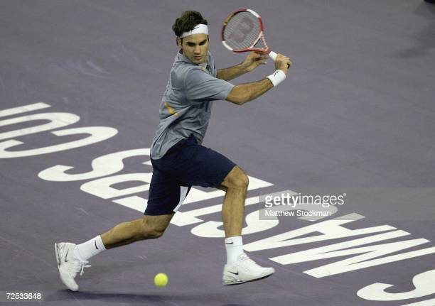 Roger Federer of Switzerland returns a shot to Andy Roddick of the United States during the round robin of the Tennis masters Cup Shanghai November...