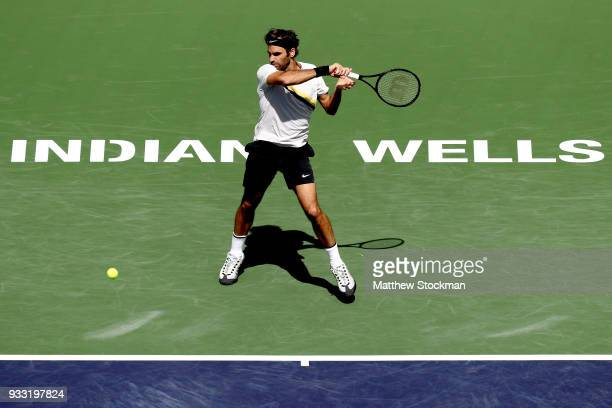 Roger Federer of Switzerland returns a shot to Borna Coric of Croatia during the semifinal match on Day 13 of the BNP Paribas Open at the Indian...