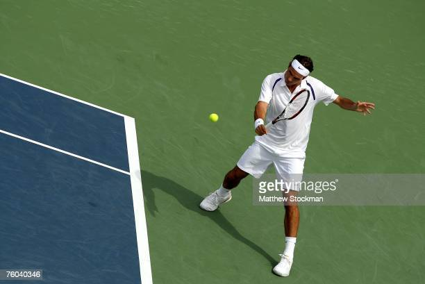 Roger Federer of Switzerland returns a shot to Fabio Fognini of Italy during the Coupe Rogers August 9 2007 at Stade Uniprix in Montreal Quebec Canada