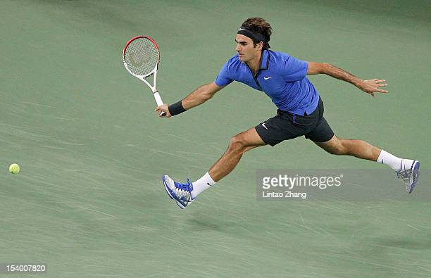 Roger Federer of Switzerland returns a shot to Marin Cilic of Croatia during the Men's Single Quarterfinals of the Shanghai Rolex Masters at the Qi...
