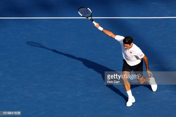 Roger Federer of Switzerland returns a shot to Novak Djokovic of Serbia in the mens final during Day 9 of the Western and Southern Open at the...