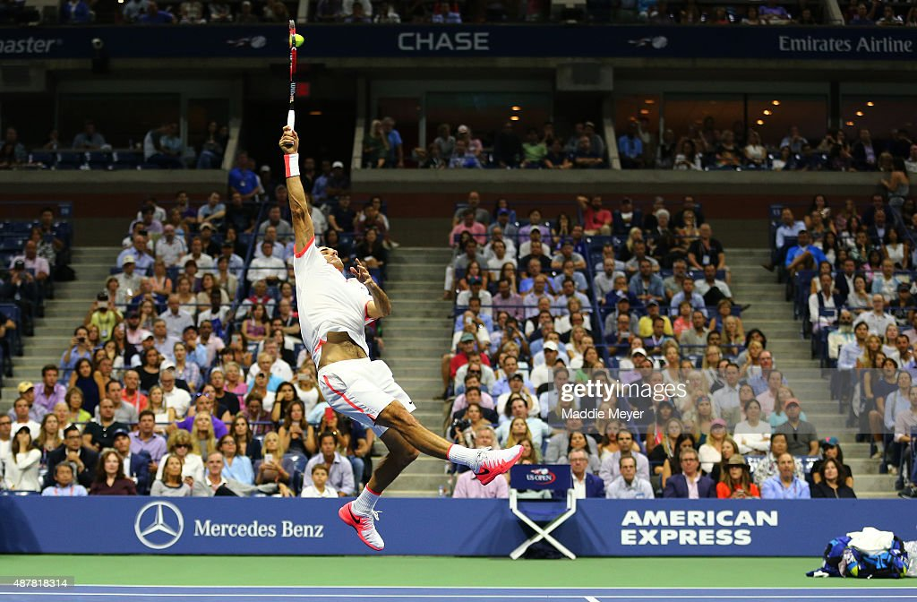 Roger Federer of Switzerland returns a shot to Stan Wawrinka of Switzerland during their Men's Singles Semifinals match on Day Twelve of the 2015 US Open at the USTA Billie Jean King National Tennis Center on September 11, 2015 in the Flushing neighborhood of the Queens borough of New York City.