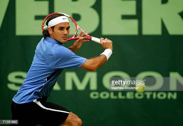 Roger Federer of Switzerland returns a shot to Tomas Berdych of the Czech Republic during the Gerry Weber Open June 18 2006 at Gerry Weber Stadium in...