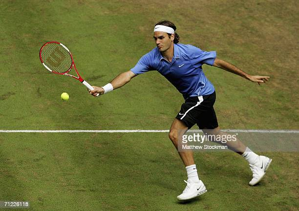 Roger Federer of Switzerland returns a shot to Tommy Haas of Germany during the Gerry Weber Open at Gerry Weber Stadium June 17, 2006 in Halle,...
