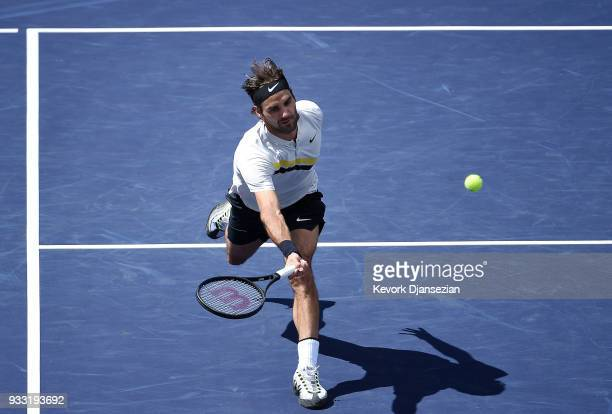 Roger Federer of Switzerland returns against Borna Coric of Croatia during the semifinal match on Day 13 of the BNP Paribas Open on March 17 2018 in...