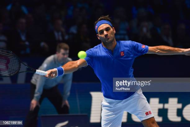 Roger Federer of Switzerland returns during his round robin match against Kevin Anderson of South Africa during Day Five of the Nitto ATP Finals at...
