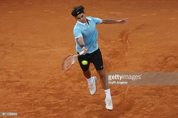 Roger Federer of Switzerland returns during the match against Andreas Seppi of Italy during day six of the Tennis Masters Series Hamburg at...