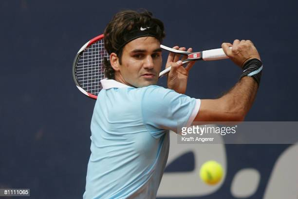 Roger Federer of Switzerland returns during the match against Fernando Verdasco of Spain during day five of the Tennis Masters Series Hamburg at...