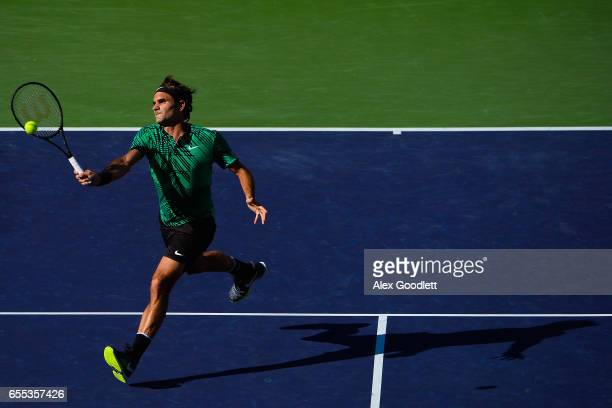 Roger Federer of Switzerland returns match point to Stan Wawrinka of Switzerland in the men's final on day 14 during the BNP Paribas Open at Indian...