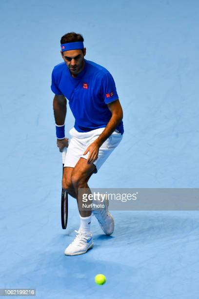 Roger Federer of Switzerland returns the ball during his round robin match against Kevin Anderson of South Africa during Day Five of the Nitto ATP...