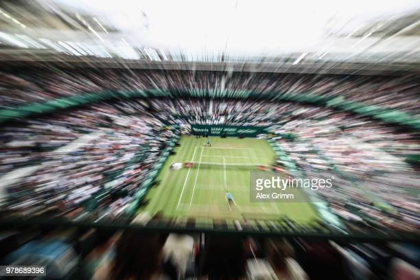 Roger Federer of Switzerland returns the ball to Aljaz Bedene of Slovenia during their first round match on day 2 of the Gerry Weber Open at Gerry...