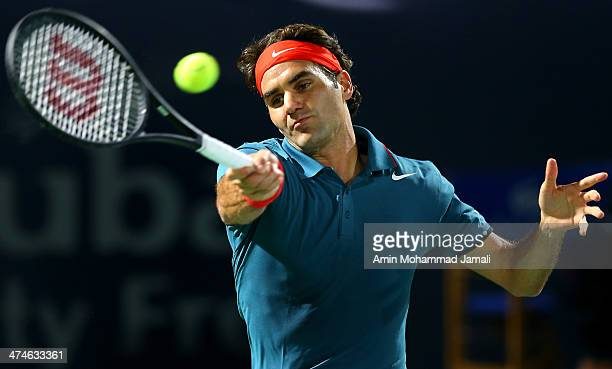 Roger Federer of Switzerland returns the ball to Benjamin Becker of Germany during their first round match of the Dubai Duty Free Tennis ATP...