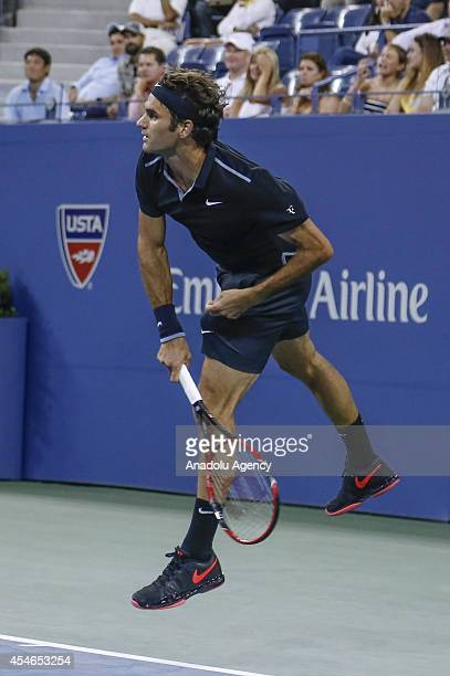 Roger Federer of Switzerland returns the ball to Gael Monfils of France during their men's singles quarterfinal tennis match on Day 11 of the 2014 US...