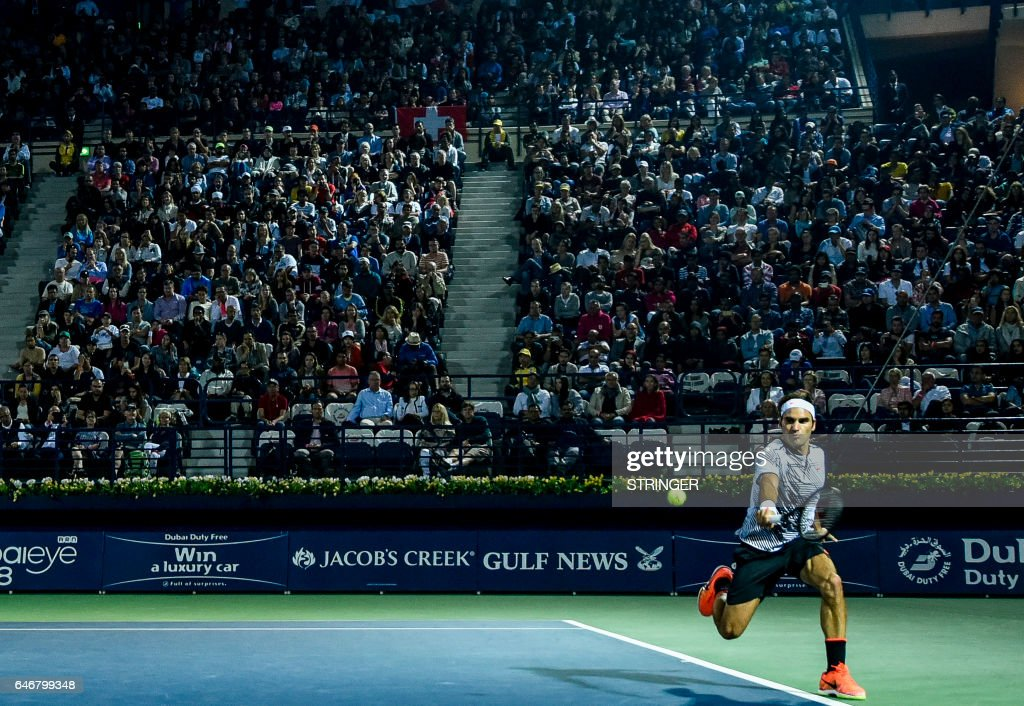 Roger Federer of Switzerland returns the ball to Russia's Evgeny Donskoy during their ATP tennis match as part of the Dubai Duty Free Championships on March 1, 2017, in Dubai. /