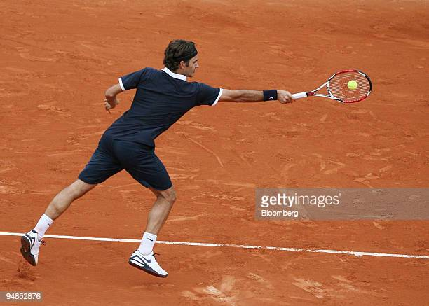 Roger Federer, of Switzerland, returns the ball to Sam Querrey, of the U.S., during the French Open in Paris, France, on Monday, May 26, 2008. The...