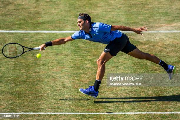 Roger Federer of Switzerland returns the Ball to Tommy Haas of Germany during their round of sixteen match of Mercedes Cup 2017 on June 14, 2017 in...