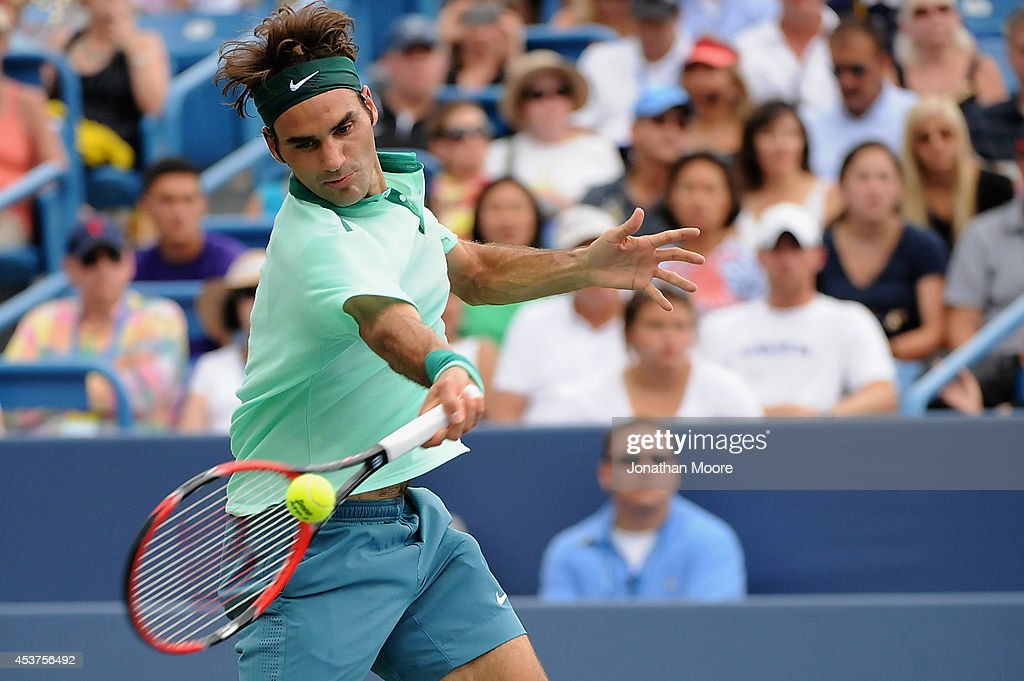 Roger Federer of Switzerland returns to David Ferrer of Spain during a final match on day 9 of the Western & Southern Open at the Linder Family Tennis Center on August 17, 2014 in Cincinnati, Ohio.