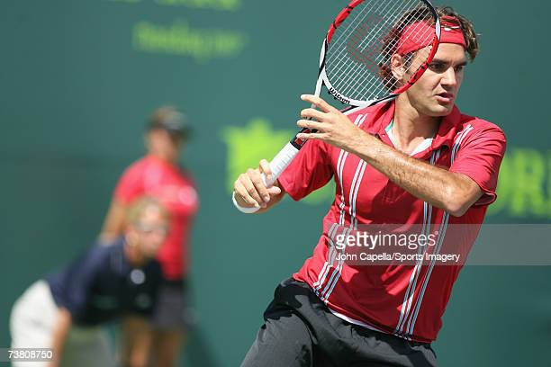 Roger Federer of Switzerland returns to Nicolas Almagro of Spain during day six at the 2007 Sony Ericsson Open at the Tennis Center at Crandon Park...