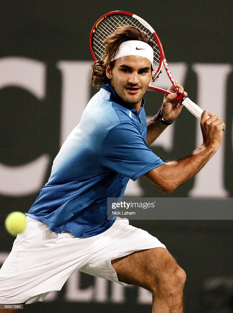 Roger Federer of Switzerland runs for a backhand during the ATP All-Star Rally for Relief at the Pacific Life Open at the Indian Wells Tennis Garden on March 11, 2005 in Indian Wells, California.