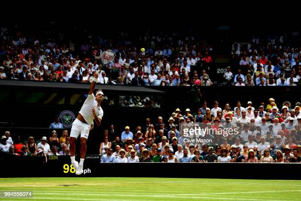 Roger Federer of Switzerland serves against Adrian Mannarino of France during their Men's Singles fourth round match on day seven of the Wimbledon...