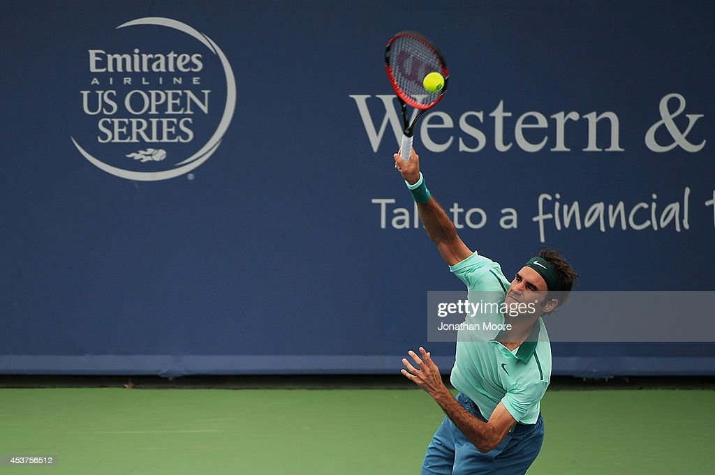 Roger Federer of Switzerland serves against David Ferrer of Spain during a final match on day 9 of the Western & Southern Open at the Linder Family Tennis Center on August 17, 2014 in Cincinnati, Ohio.