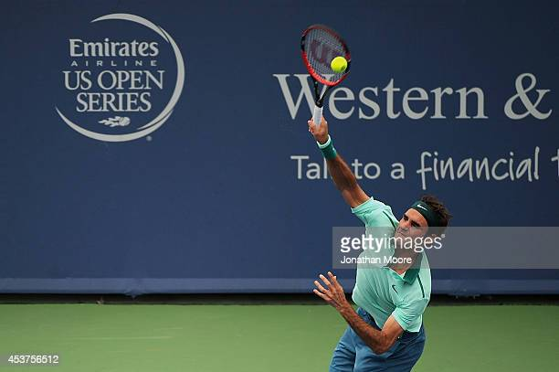 Roger Federer of Switzerland serves against David Ferrer of Spain during a final match on day 9 of the Western Southern Open at the Linder Family...