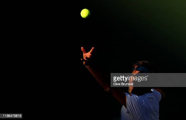 Roger Federer of Switzerland serves against Dominic Thiem of Austria during their men's singles final on day fourteen of the BNP Paribas Open at the...