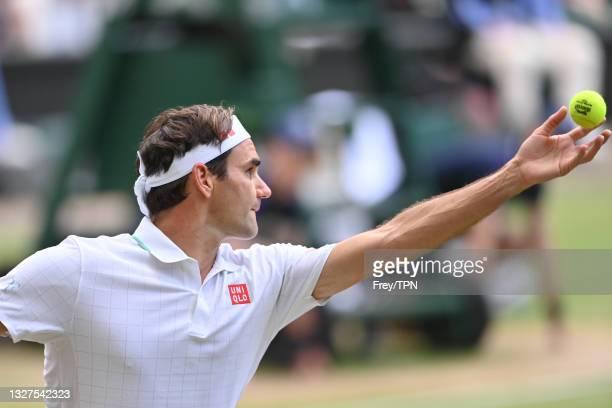 Roger Federer of Switzerland serves against Hubert Hurkacz of Poland in the quarter finals of the gentlemen's singles during Day Nine of The...