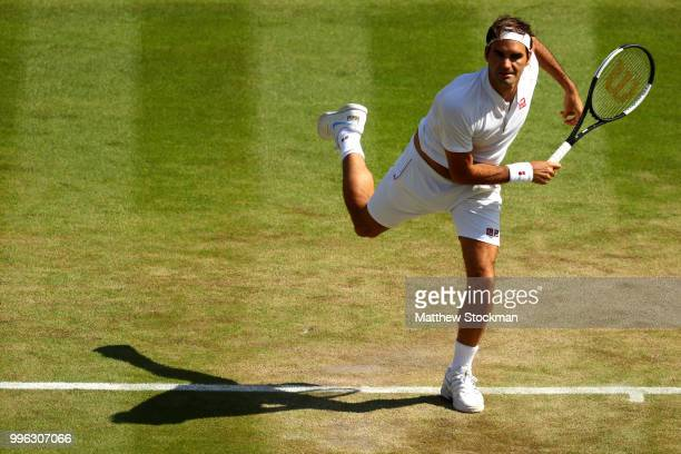 Roger Federer of Switzerland serves against Kevin Anderson of South Africa during their Men's Singles QuarterFinals match on day nine of the...