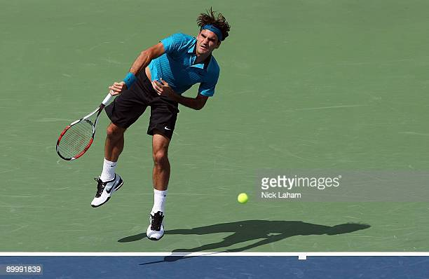 Roger Federer of Switzerland serves against Lleyton Hewitt of Australia during day five of the Western Southern Financial Group Masters on August 21...