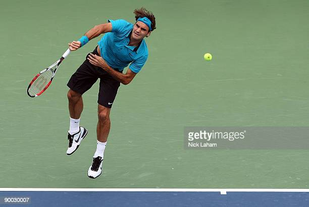 Roger Federer of Switzerland serves against Novak Djokovic of Serbia in the Singles Final during day seven of the Western Southern Financial Group...