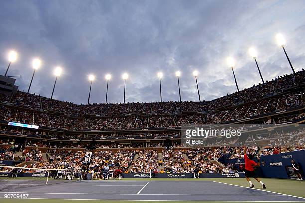 Roger Federer of Switzerland serves against Novak Djokovic of Serbia during the Men�s Singles Semifinal match on day fourteen of the 2009 US Open at...