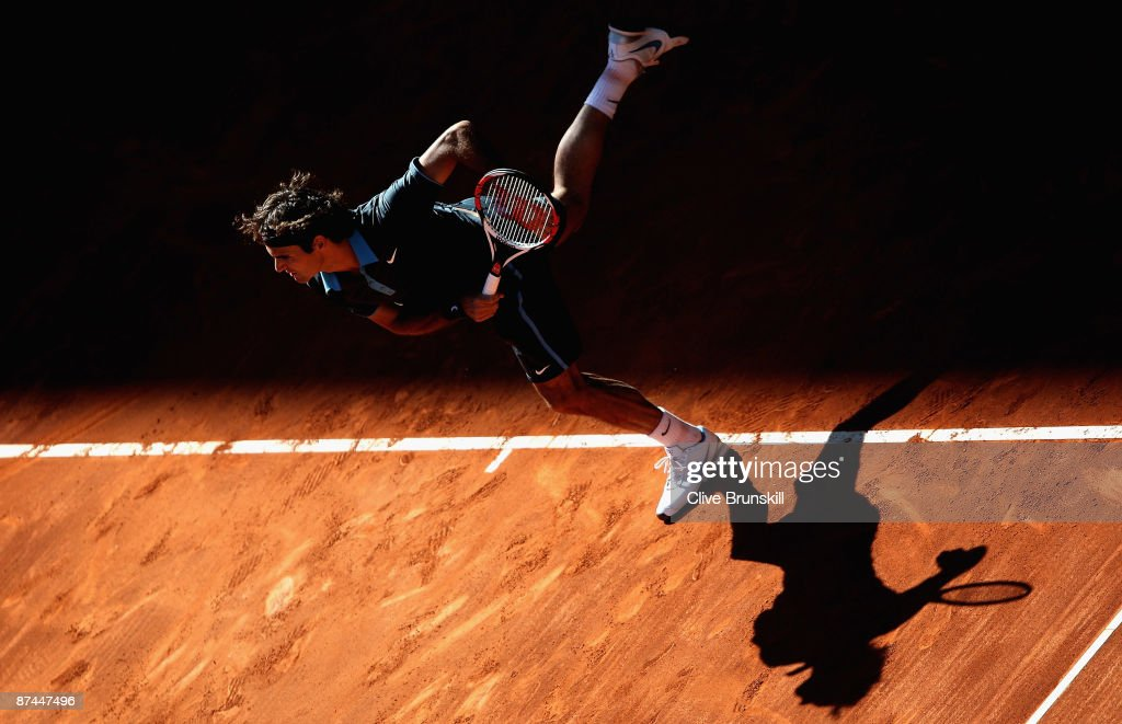 Roger Federer of Switzerland serves against Rafael Nadal of Spain in the mens final during the Madrid Open tennis tournament at the Caja Magica on May 17, 2009 in Madrid, Spain.