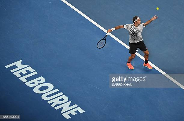 Roger Federer of Switzerland serves against Rafael Nadal of Spain during the men's singles final on day 14 of the Australian Open tennis tournament...