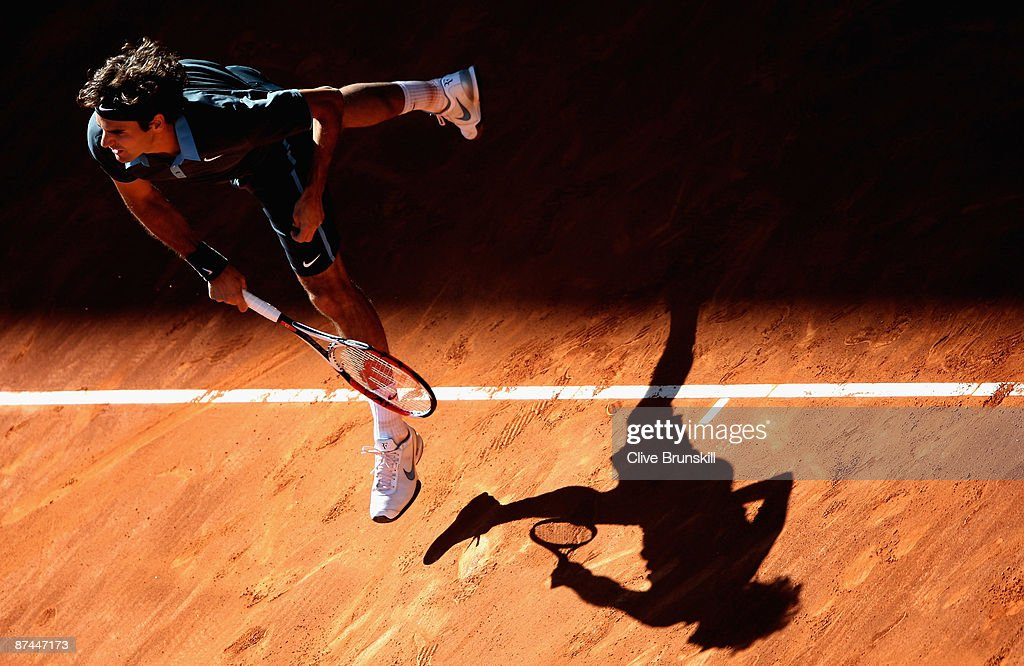 Roger Federer of Switzerland serves against Rafael Nadal of Spain during the Madrid Open Men's Final at the Caja Magica on May 17, 2009 in Madrid, Spain.
