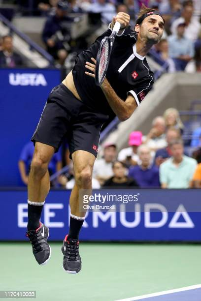Roger Federer of Switzerland serves against Sumit Nagal of India during their Men's Singles first round match on day one of the 2019 US Open at the...